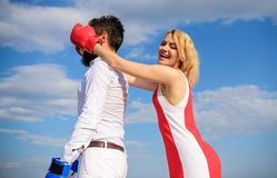 Couple in love boxing gloves blue sky background. Girl close his eyes boxing gloves. Cunning strategy win. Savvy key to. Success. Blind boxer can not attack stock photography