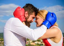 Couple in love boxing gloves hug blue sky background. Man beard and girl cuddle happy after fight. Family life happiness. And relation problems. Reconciliation royalty free stock photography