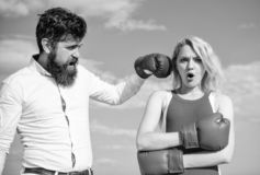 Couple in love boxing gloves sky background. Man punch girl boxing glove. She did not expect be attacked. Prepare for. Sudden attack. Woman undergoes violence stock photo