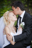 Couple in love bride and groom together in bridal summer day. Wedding: couple in love bride and groom together in bridal summer day enjoy a moment of happiness Royalty Free Stock Images