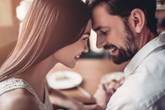 Couple in love in cafe royalty free stock photography