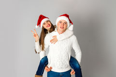 Couple in love celebrates christmas in santa hat Stock Image
