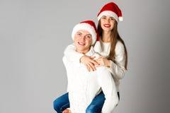 Couple in love celebrates christmas in santa hat Stock Photo