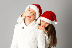 Couple in love celebrates christmas in santa hat Royalty Free Stock Images