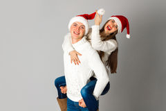 Couple in love celebrates christmas in santa hat Royalty Free Stock Image