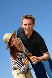 Couple love champagne. Young handsome couple in love with champagne against blue sky stock photo