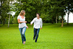 Couple in love chasing each other royalty free stock photo