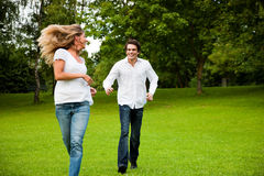 Couple in love chasing each other stock photography