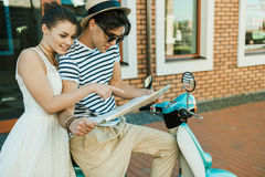 Couple in love choosing destination on map in hands Stock Images