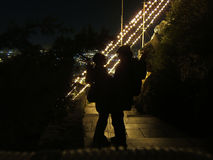 Couple love in christmas. Two people silhouette in love. Athens, Greece Stock Photo