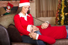 Couple in love in christmas eve. Beautiful young couple in christmas eve royalty free stock image