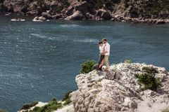 Couple in love on the cliff by the sea stock images