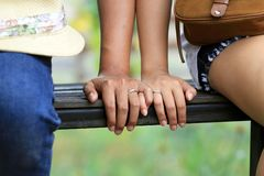 Couple in love. Close-up of boy and girl holding by hands each other. the lover stock photo