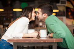 Couple in love at a coffee shop Stock Images