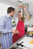 Couple in love cooking together in the kitchen and have fun duri Stock Images