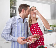 Couple in love cooking together in the kitchen and have fun Stock Image