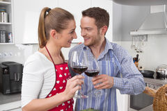 Couple in love cooking together in the kitchen and have fun - re Royalty Free Stock Photography
