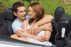 Couple in love cuddling in the backseat stock photo