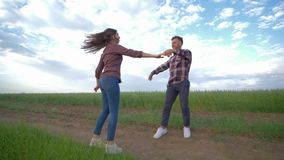 Couple in love dancing in slow motion and enjoy weekend outdoors at countryside on background of sky, happy stock video footage
