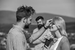 Couple in love dating while jealous husband fixedly watching on background. Unrequited love concept. Lovers meeting. Outdoor flirt romance relations. Couple royalty free stock image