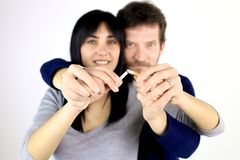 Couple in love deciding to stop smoking Stock Photography