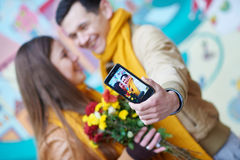 Couple in love doing selfie on smartphone outdoors Stock Images