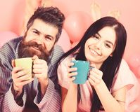 Couple in love drink coffee in bed. Couple relax in morning with coffee. Family tradition concept. Man and woman in stock photos