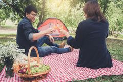 Couple in love drink a orange juice on summer picnic, leisure, h Stock Photography