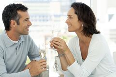 Couple in love drinking champagne - middle aged people stock image