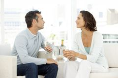 Couple in love drinking champagne - middle aged people stock photo