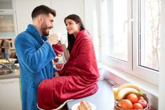 Couple in love drinking coffee in kitchen Royalty Free Stock Photo