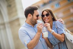 Couple in love drinking juice, outdoor stock photos