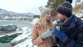 Couple drinking tea, coffee cup in the winter. Couple in love drinking tea, coffee cup in the winter forest. Slow motion stock video footage