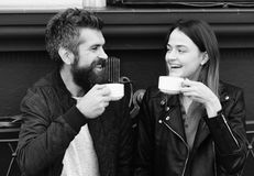 Couple in love drinks coffee break. Hot beverage and lunch. Woman and man with happy faces. Couple in love drinks espresso during coffee break. Hot beverage and Royalty Free Stock Images
