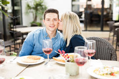 Couple in love eating at a restaurant royalty free stock image