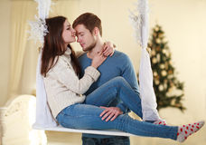 Couple in love embrace each other at home on festive decorations Stock Photos