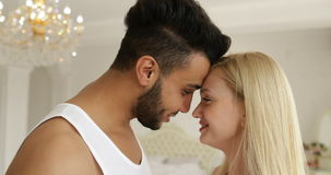Couple love embrace smile standing face to face mix race man woman hug morning bedroom stock footage