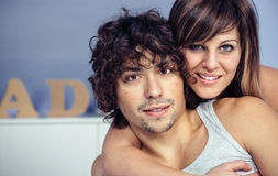 Couple in love embracing and smiling on bedroom Royalty Free Stock Images