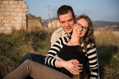 Couple in love on engagement day in natural park. Stock Image