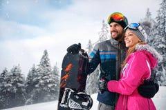 Couple enjoy skiing on mountain Stock Images
