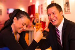 Couple in love enjoying drinks Royalty Free Stock Images