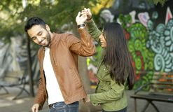 Couple in love. Enjoying happy in public park royalty free stock photography