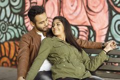 Couple in love. Enjoying happy in public park royalty free stock photo