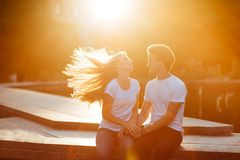 Couple in love enjoying moments during sunset stock image