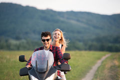 Couple in love enjoying a motorbike ride in countryside. Stock Photography