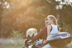 Couple in love enjoying a motorbike ride in countryside. Stock Photos