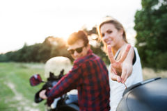 Couple in love enjoying a motorbike ride in countryside. Stock Image