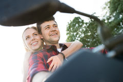 Couple in love enjoying a quad bike ride in countryside. Royalty Free Stock Photo
