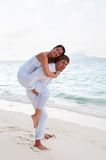 Couple in love enjoying a summer holiday. Stock Photos