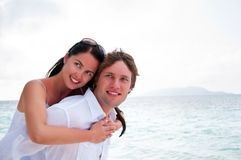 Couple in love enjoying a summer holiday. Young couple in love enjoying a summer holiday Stock Photo